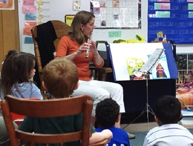 Teacher playing flute
