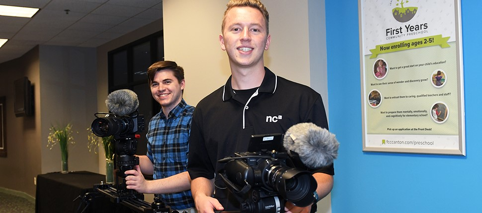 All In event event with two high school boys holding camera equipment