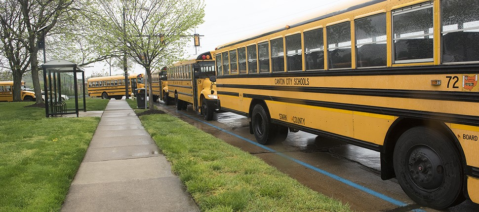 School buses drop off donations