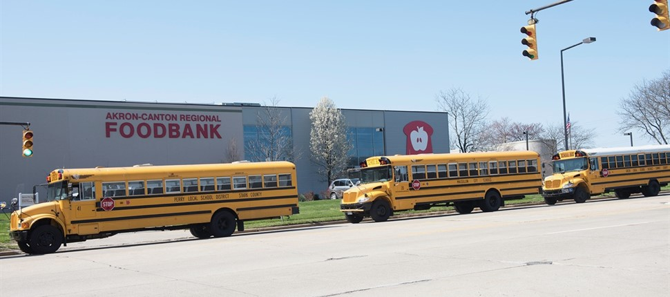 Member district school buses drop off food donations to the Akron-Canton Regional Foodbank